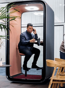 A person using a framery one privacy pod